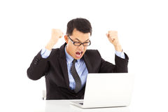Successful businessman excited to raise his hands. Over white background Royalty Free Stock Images