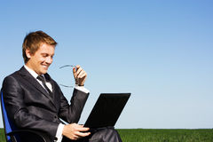 Successful businessman in the field, with glasses Royalty Free Stock Photo