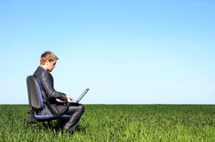 Successful businessman, in the field with laptop Stock Photos