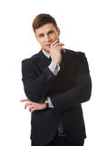 Successful businessman with finger under chin. Successful thoughtful businessman with finger under chin stock images