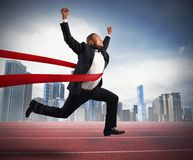 Successful businessman in a finishing line Royalty Free Stock Photos