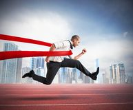 Successful businessman on the finishing line. Of a track royalty free stock images