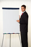 Successful businessman with a flipchart for Stock Image