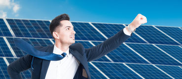 Successful businessman flying over photovoltaic installation stock images
