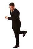 Successful businessman in formal suit chacking time on wrist wat Royalty Free Stock Images