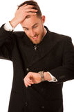Successful businessman in formal suit chacking time on wrist wat Stock Photography