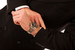 Successful businessman in formal suit chacking time on wrist wat Stock Photos