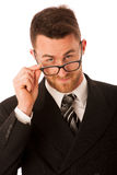 Successful businessman in formal suit looking over glasses isola. Ted over white Royalty Free Stock Images