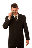 Successful businessman in formal suit looking over glasses isola. Ted over white Stock Photos