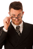 Successful businessman in formal suit looking over glasses isola. Ted over white Royalty Free Stock Image