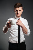 Successful businessman in formalwear holding cup of coffee while standing Royalty Free Stock Image