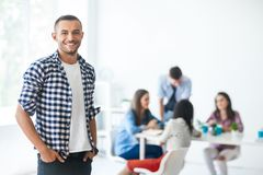 Successful businessman in front of diverse business team. In modern office Stock Image