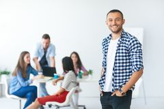 Successful businessman in front of diverse business team. In modern office Royalty Free Stock Image
