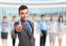 Successful businessman in front of his team Royalty Free Stock Images