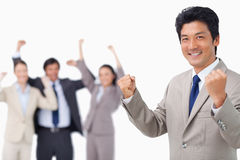 Successful businessman getting celebrated by colleagues Stock Photos