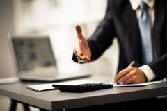 Successful businessman giving a hand Stock Photography