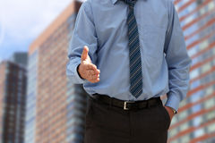 Successful businessman giving a hand. Stock Images