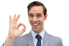 Successful businessman giving ok sign Stock Images