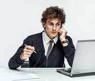 Successful businessman going to make a call by cell phone Stock Images