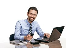 Successful businessman going to make a call by cellphone while working with laptop isolated on white Stock Photography