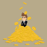 Successful businessman on gold stack coins Royalty Free Stock Images