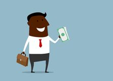 Successful businessman with a handful of money Stock Photography