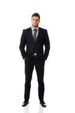 Successful businessman with hands in pockets. Stock Image
