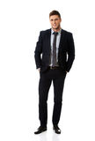 Successful businessman with hands in pockets. Royalty Free Stock Image