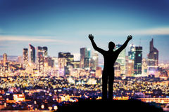 Successful businessman with hands up facing city business downtown Royalty Free Stock Photos