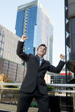 Successful businessman happy doing victory sign Royalty Free Stock Images