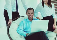 Successful businessman with his assistants in a discussion of the information from the laptop. Office life stock photos
