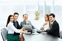 Successful businessman and his business team meeting Stock Photo