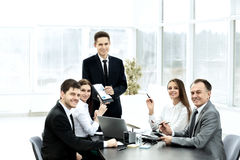 Successful businessman and his business team meeting in modern office Royalty Free Stock Photography