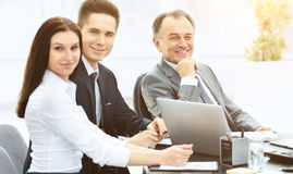 A successful businessman and his business team meeting in a modern office Royalty Free Stock Image