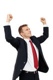 Successful businessman holding arms up, success! Royalty Free Stock Images