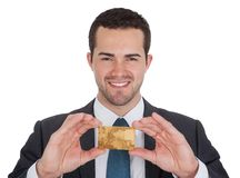 Successful businessman holding credit card Royalty Free Stock Photo