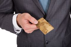 Successful businessman holding credit card Royalty Free Stock Photos