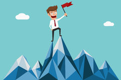 Successful businessman holding flag on top of mountain. Success concept. Royalty Free Stock Photo