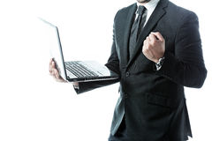Successful businessman holding a laptop Royalty Free Stock Image
