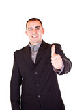 Successful businessman holding thumb up Royalty Free Stock Images