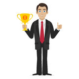 Successful businessman holds cup Royalty Free Stock Photos