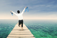 Successful businessman on jetty Royalty Free Stock Images