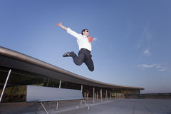 Successful businessman jumping. stock photo