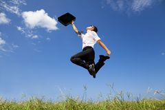 Successful businessman jumping Stock Images