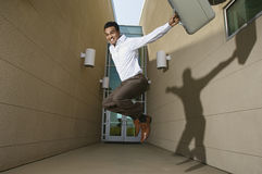 Successful Businessman Jumping Stock Image