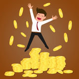 Successful businessman jumping on gold coins Royalty Free Stock Photo