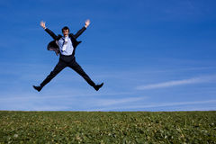 Successful businessman jumping for joy Stock Images