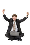 Successful businessman with laptop Stock Photography