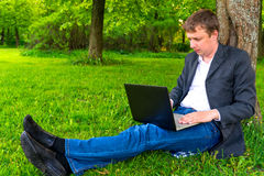 Successful businessman with laptop Stock Images