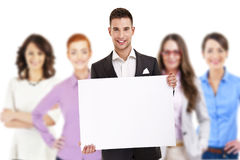Successful businessman leading a group with board Stock Images